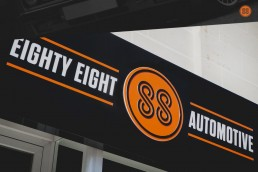 Close up shot of 88 Automotive sign on shop in Ħal Għaxaq