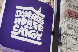 Dylan's House of Candy shop purple illuminated sign