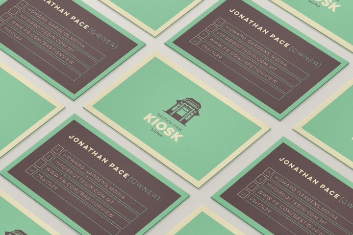 Mdina Kiosk business cards layout on table