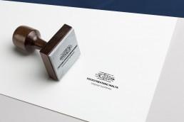 Proofreading Malta stamp on paper