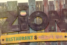 Wooden signage for Zion reggae bar Malta