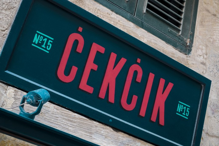 Exterior close up shot of Cekcik hand painted sign in Valletta