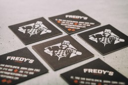 Close up shot of printed business cards for Fredy's Diner
